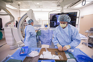 The technologist and the doctor work together to safely and accurately complete the procedure.
